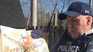 A YouTube screengrab of Fort Smith RCMP Detachment Commander Sargeant Geoffrey Peters reading a children's storybook as part of a library program in May 2020.