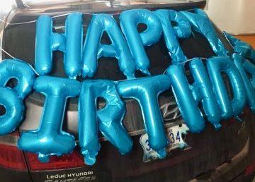 A decorated vehicle awaits the next Hay River birthday parade
