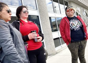 Friends and family of Breanna Menacho, including Melva Mantla, left, gathered outside the Yellowknife courthouse on Tuesday to show support for the 22-year-old, who was killed on May 6