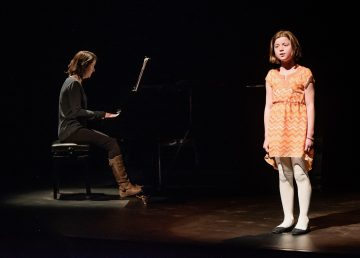 Sadee Mitchell, right, sings at a 2019 performance in Yellowknife, accompanied on piano by Claire Singer