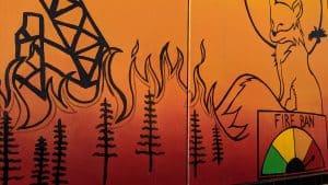 Transformer box art illustrates an intense fire season. Sarah Pruys/Cabin Radio