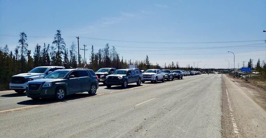Vehicles line up outside Yellowknife's dump on May 4, 2020