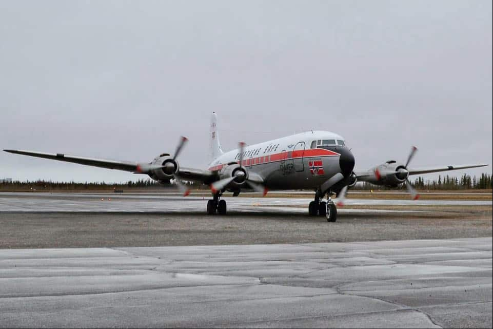 The Braathens SAFE DC-6 prepares to leave Yellowknife for Norway