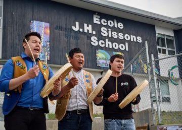 Drummers perform in front of École JH Sissons on June 26, 2020