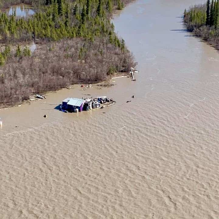 An aerial photo taken around 6 p.m. Sunday shows the waters of the Mackenzie near Kalinek point flooding Jimmy Kalinek's cabin