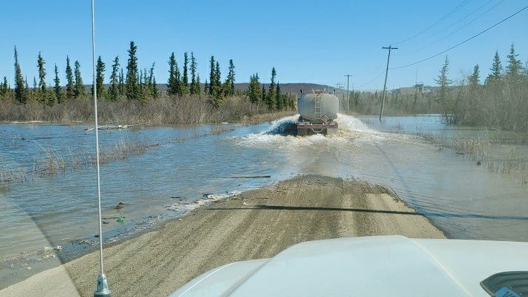 Tank Farm Road flooded on Sunday, leading Arctic Petroleum Services to close its site