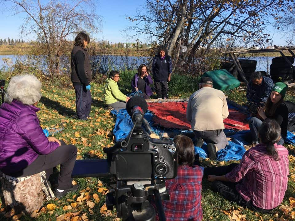 Elders, youth, fluent language speakers and staff members share teachings out on the land.