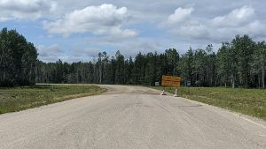 A closure sign by the side of Highway 7 in July 2020