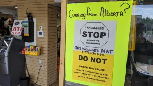 A sign at Big River gas station warns travellers to quarantine and not enter the store if coming from Alberta
