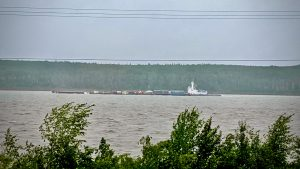 A barge makes its way down the Mackenzie River past Fort Simpson on July 23, 2020