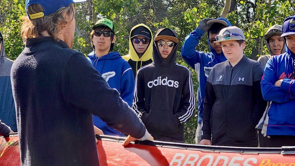 Youth watch guide Jack Panayi at a safety briefing ahead of a canoe trip east of Yellowknife