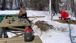 Rotarians working on the new bridge in April. Photo: Yellowknife Rotary True North
