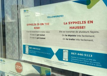A sign in the window of a Yellowknife clinic warns syphilis is on the rise