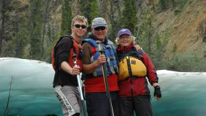 Taylor Pace, left, with his parents Al Pace and Lin Ward. The family owns Canoe North Adventures. Submitted photo