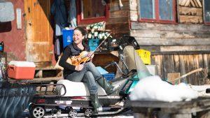 Andrea Bettger outside her cabin