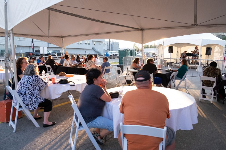 Guests enjoy local musician Jim Taylor's performance during this weekend's 47 Street Festival