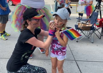 A young girl gets a rainbow painted on her cheek at the 2020 Rainbow Run in Yellowknife