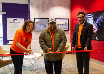 Yellowknife Mayor Rebecca Alty, Dettah Chief Edward Sangris, and Scotiabank branch manager Baldeep Bajwa open a new legacy space dedicated to residential schools
