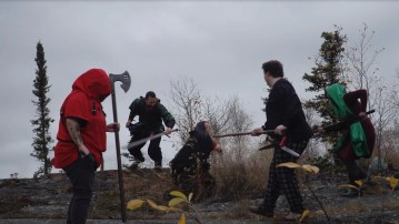 A group of mercenaries fight a child-eating witch as part of Yellowknife's live action role-play (LARPing) team
