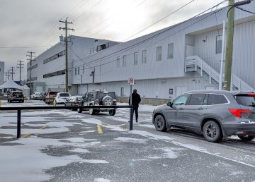 A line of vehicles waits at Yellowknife's Covid-19 drive-through testing centre on October 17, 2020