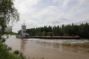 One of the barges being dragged away from Kátł'odeeche First Nation in Hay River