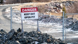 A warning sign at an entrance to the Giant Mine site outside Yellowknife