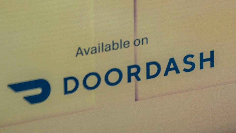 A sign at a Yellowknife McDonald's location indicates customers can order via DoorDash