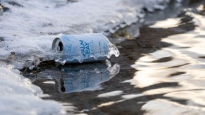 A discarded can of Palm Bay lies frozen on the shore of Madeline Lake in October 2020