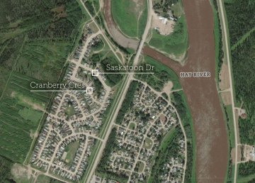 A map of Hay River shows Saskatoon Drive and Cranberry Crescent