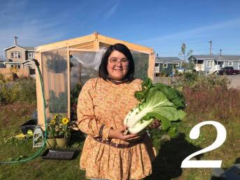 Tamara Voudrach from Inuvik showcases bok choy she grew from seed