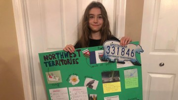 Lily's project on the Northwest Territories was a hit with her teacher and classmates
