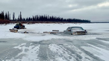 A photo posted to Facebook by the Department of Environment and Natural Resources shows a vehicle in the ice in the Beaufort Delta