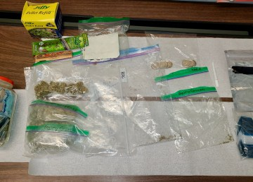 Drugs, trafficking paraphernalia, and cash are seen in an RCMP handout image in November 2020