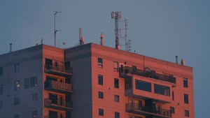 The northern heights apartment building at sunset in November 2020. Sarah Pruys/Cabin Radio