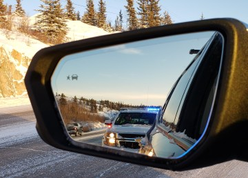 An RCMP handout image of a vehicle being stopped by police in the NWT
