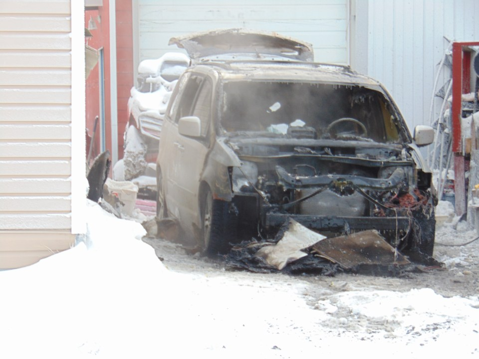 Firefighters battled a vehicle fire outside a Bigelow Crescent residence on Monday afternoon