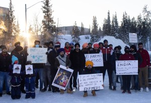 Members of Yellowknife's Indian community protest in Somba K'e Park in support of Indian farmers
