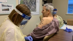 Bruce Jonasson receives a Covid-19 vaccination at Yellowknife's Aven Manor on December 31, 2020