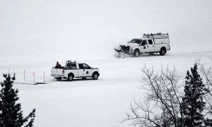Workers prepare the Dettah ice road in December 2020