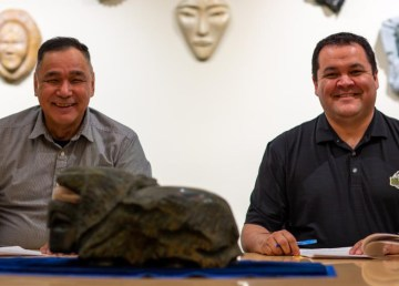 Inuvialuit Development Corporation Chair Patrick Gruben, left, and Gwich'in Tribal Council Grand Chief, Ken Smith, sign a shareholders agreement to form Delta North Alliance. Photo: Inuvialuit Regional Corporation