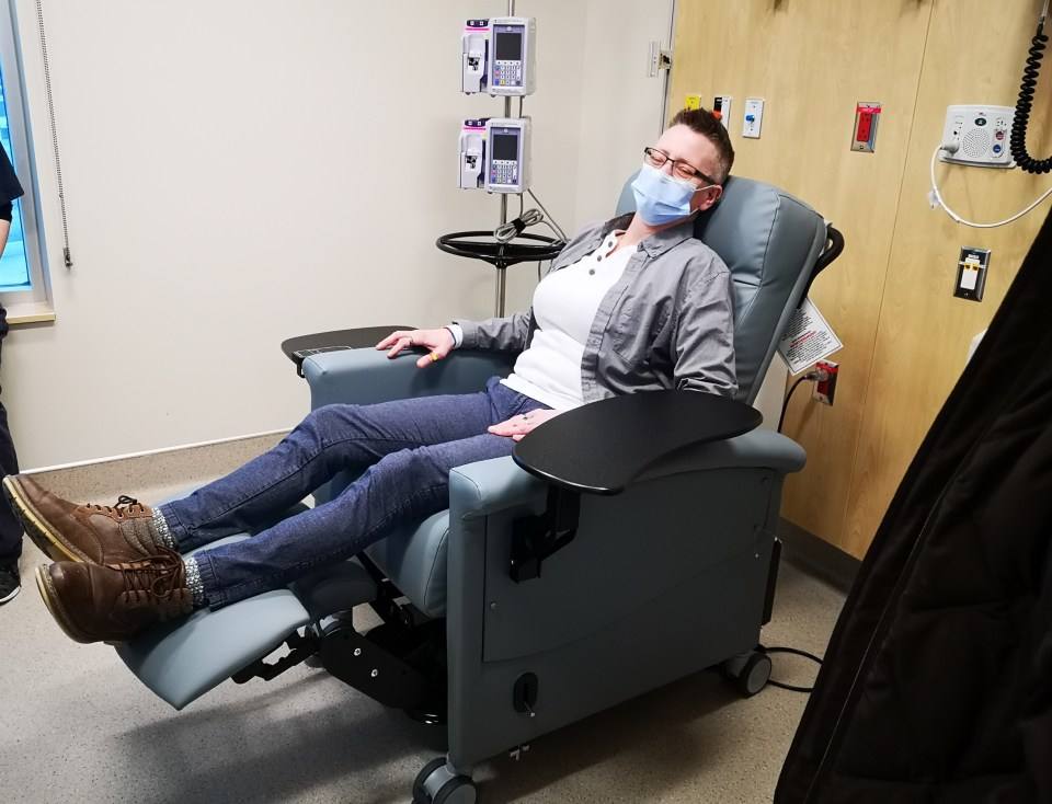 Traci Mercer-Sproule in a power recliner purchased using funds from the Robin's Nest initiative