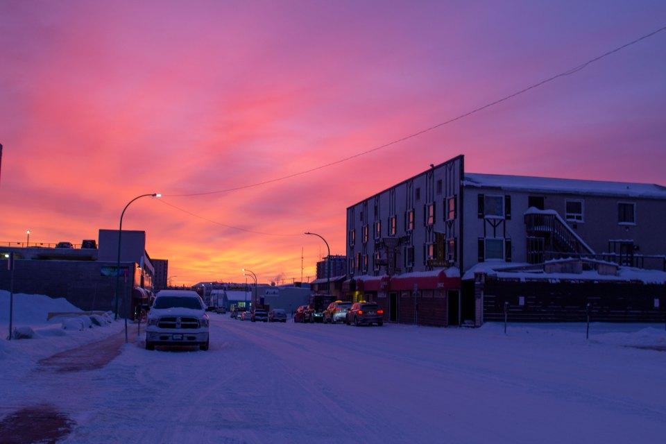 Sunrise over Yellowknife's Gold Range building in December 2020