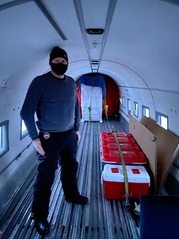 A specialized vaccine freezer and Covid-19 testing supplies arrive in Inuvik on December 20, 2020, escorted by an NWT technician