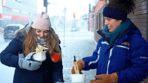 Sarah Sibley, left, and Meaghan Brackenbury with noodles during a slightly chilly December Yellowknife day