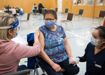 A nurse vaccinates a Dettah resident in January 2021