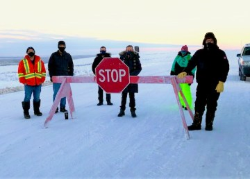 Premier Caroline Cochrane, centre, with border patrol staff on the Dempster Highway in January 2021. Photo: GNWT
