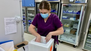 Pharmacist technician Kelly Irwin packs Covid-19 vaccines destined for long-term care homes in Fort Smith and Fort Simpson in January 2021