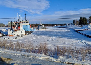 Boats docked in Hay River in winter