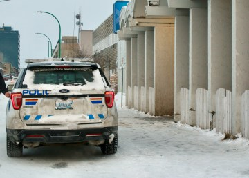 An RCMP officer leaves Yellowknife's day shelter and sobering centre following the passing of Jerry Akoak, 38, on January 8, 2021