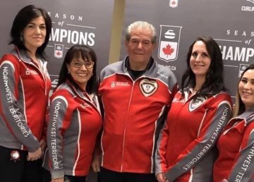 Paul Delorey, centre, is seen in a photo published to Twitter by Curling Canada